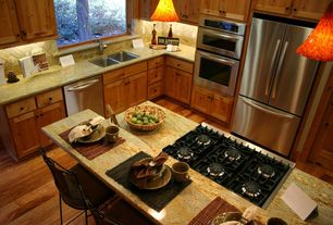 Traditional Kitchen with Hardwood floors, Breakfast bar, L-shaped, Formica counters, Pendant light, Kitchen island