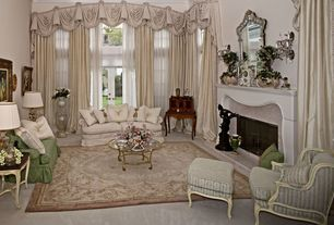 Eclectic Living Room with Transom window, Cathedral ceiling, French doors, Wall sconce, Carpet, Crown molding