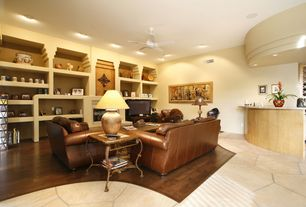 Traditional Living Room with Built-in bookshelf, Ceiling fan, Fireplace, Standard height, Hardwood floors, can lights