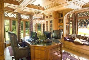 Traditional Home Office with Arched window, Crown molding, Chandelier, Laminate floors, Built-in bookshelf, Casement