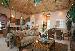 Tropical Great Room with travertine floors, Ceiling fan, Exposed beam, Pendant light