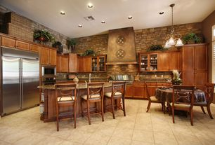 Rustic Kitchen with can lights, partial backsplash, High ceiling, Casement, stone tile floors, Breakfast bar, Breakfast nook