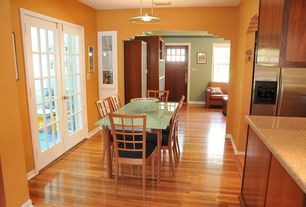 Craftsman Dining Room with Pendant light, French doors, High ceiling, Laminate floors