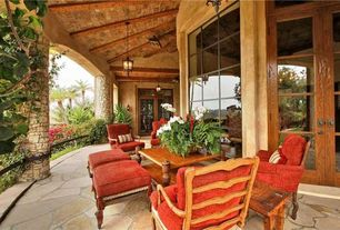 Mediterranean room with Wrap around porch, exterior stone floors, Transom window, French doors