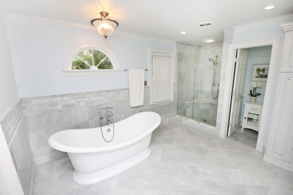 Traditional Master Bathroom with frameless showerdoor, Arched window, Crown molding, Master bathroom, flush light
