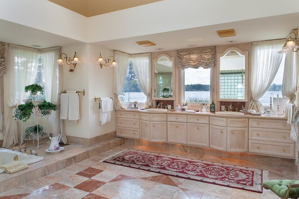 Traditional Master Bathroom with Simple marble counters, Framed Partial Panel, Bathtub, full backsplash, Double sink