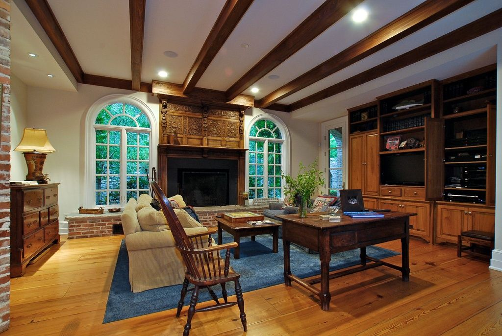 Traditional Living Room with Fireplace, Arched window, Milliken Modern Times Harmony Blue Jay Area Rug, Glass panel door