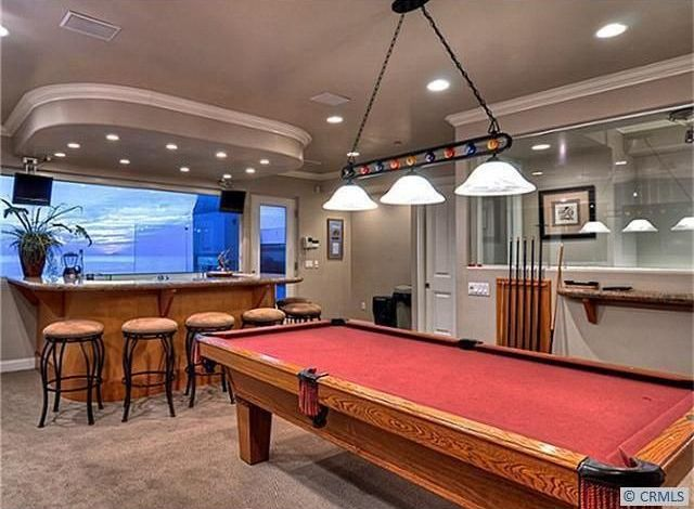 Traditional Game Room with Carpet, Standard height, Pendant light, Crown molding, can lights, specialty door