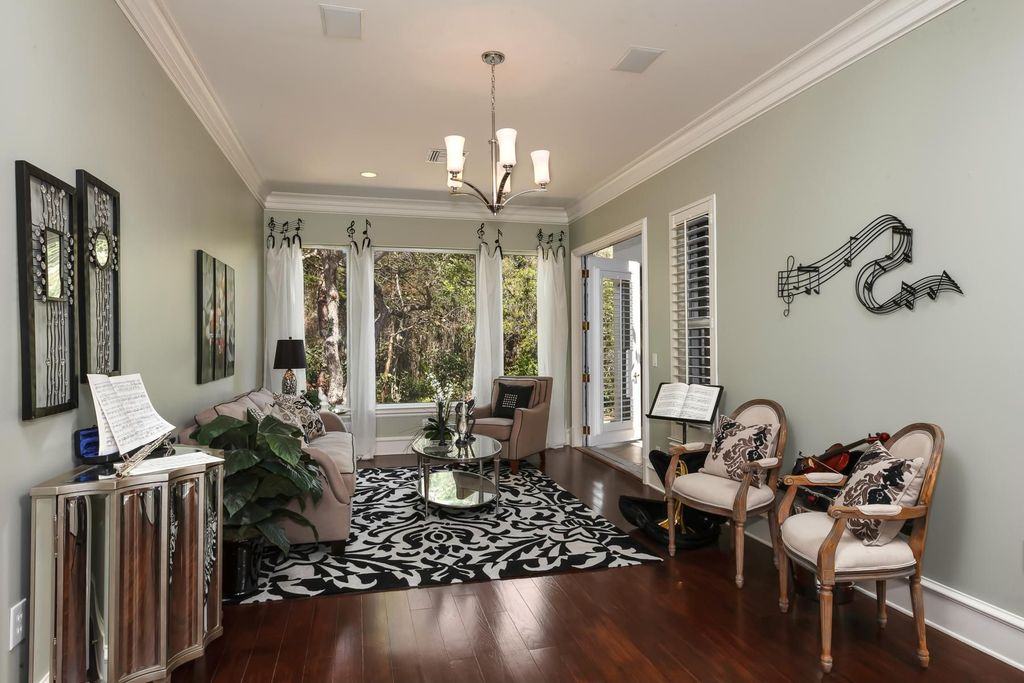 Contemporary Living Room with double-hung window, Laminate floors, can lights, Standard height, Crown molding, Chandelier