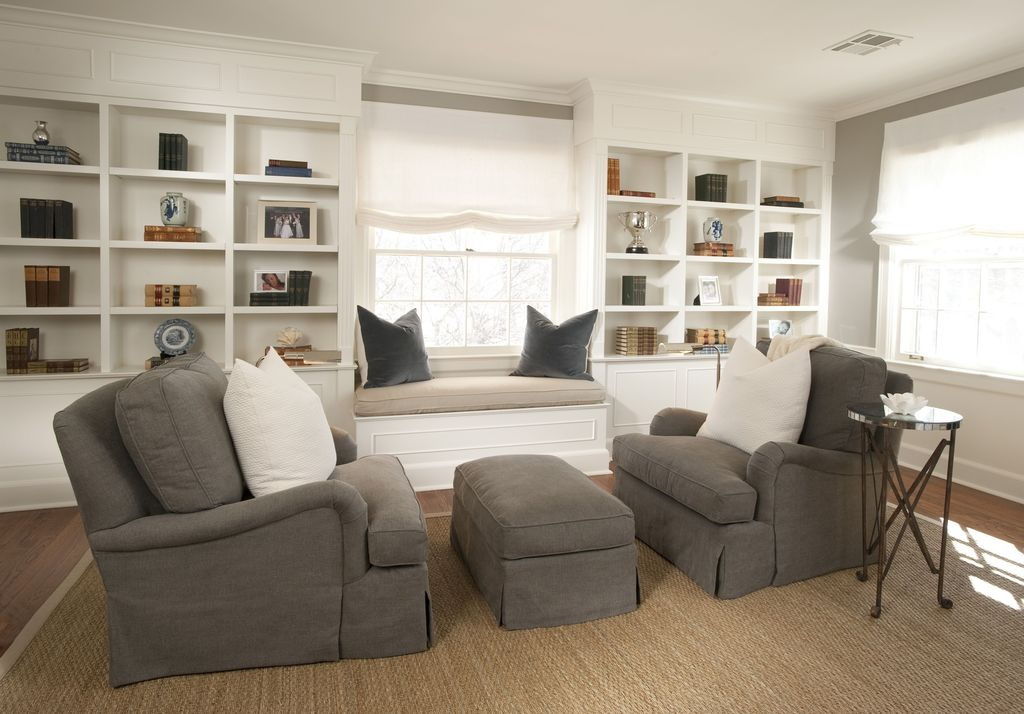 Traditional Living Room with English roll arm slipcovered ottoman - restoration hardware, Built-in bookshelf, Window seat