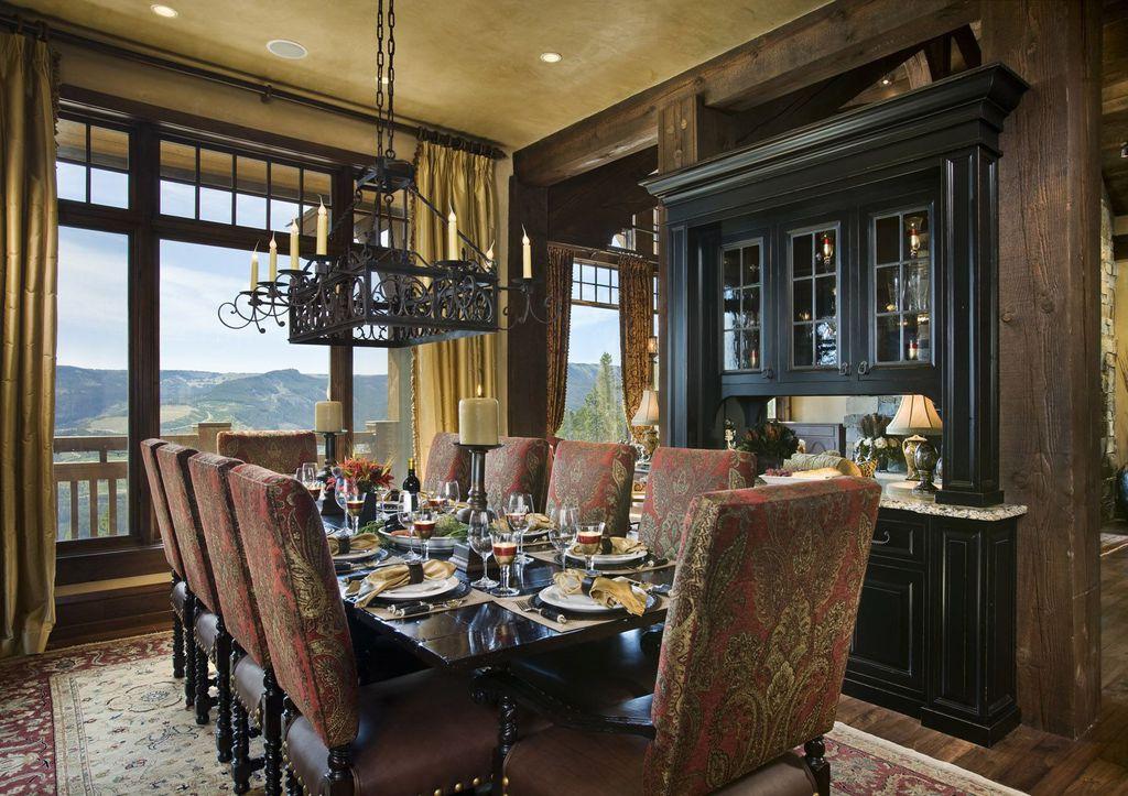 Eclectic Dining Room with picture window, Standard height, Chandelier, Built-in bookshelf, Hardwood floors, can lights