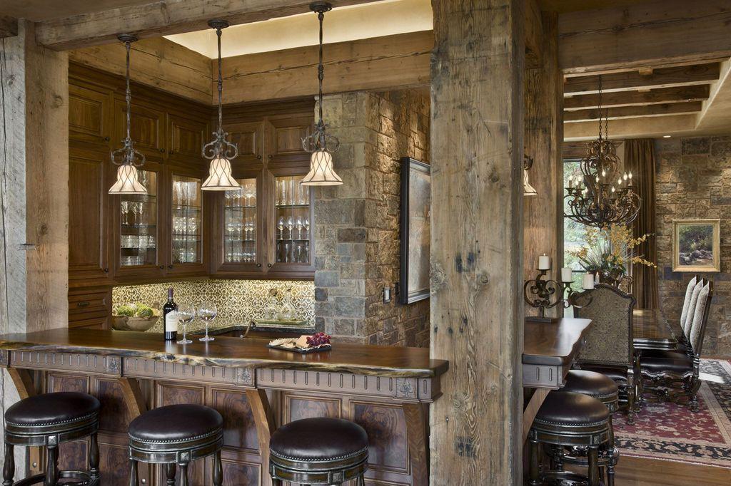Rustic Bar with Built-in bookshelf, Exposed beam, Pendant light, Standard height, specialty window, Hardwood floors