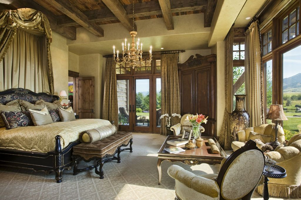 Traditional Master Bedroom with French doors, High ceiling, six panel door, Carpet, Paint, Bay window, Exposed beam