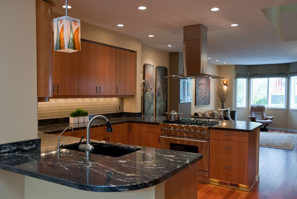 Contemporary Kitchen with Glass Tile, gas range, Island Hood, Standard height, Undermount sink, European Cabinets, can lights