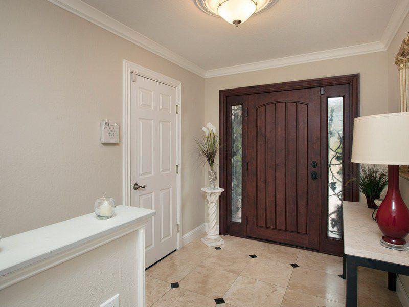 Traditional Entryway with Standard height, six panel door, flush light, Crown molding, travertine tile floors, specialty door