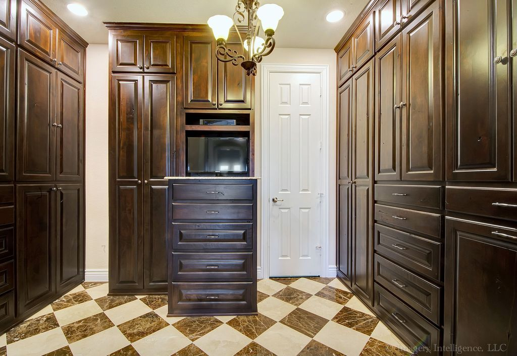 Traditional Closet with Built-in bookshelf, Chandelier, Standard height, complex marble floors, Crown molding, can lights