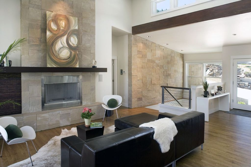 Contemporary Living Room with specialty window, High ceiling, Fireplace, can lights, French doors, metal fireplace