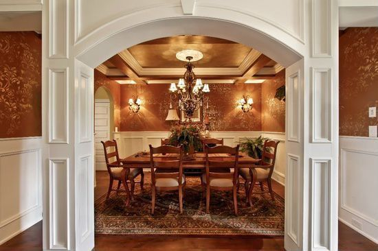 Traditional Dining Room with Standard height, Chandelier, Laminate floors, Box ceiling, Crown molding, interior wallpaper