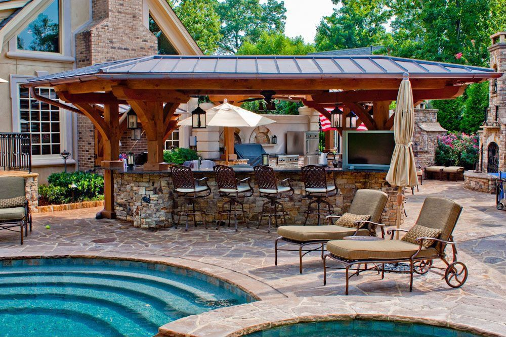rustic patio with pool with hot tub outdoor kitchen garden treasures