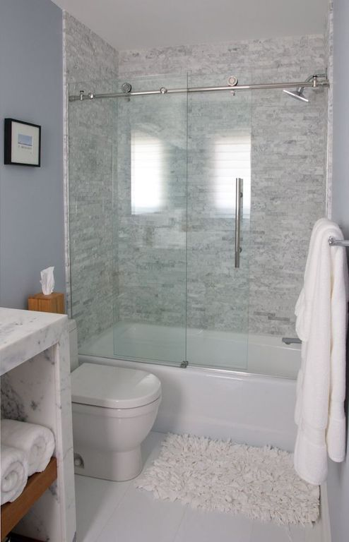 Contemporary Full Bathroom with Concrete tile , Ann sacks white thassos square field, stone slab showerbath
