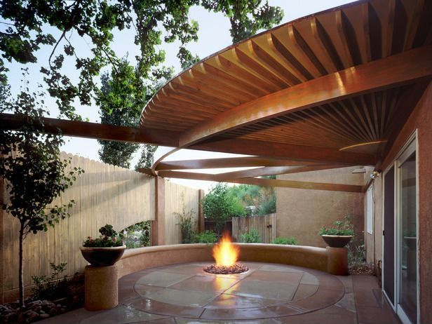Contemporary Patio with Fence, exterior awning, French doors, exterior stone floors, Trellis, Fire pit