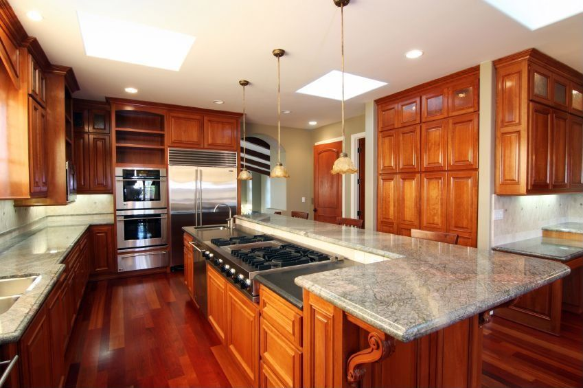 Traditional Kitchen with electric cooktop, Large Ceramic Tile, built-in microwave, Simple granite counters, Kitchen island