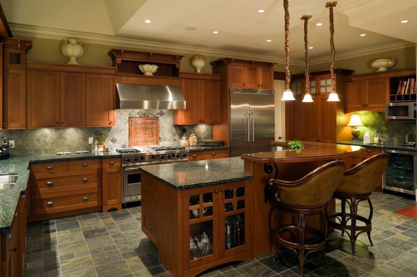 Traditional Kitchen with Glass panel, Slate, Flat panel cabinets, Crown molding, Wine refrigerator, Simple granite counters