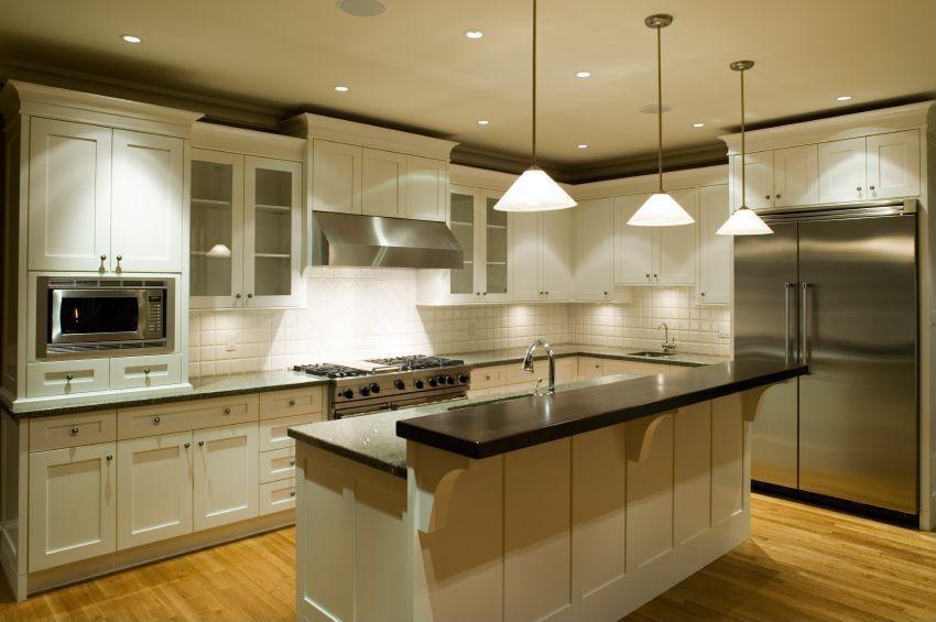 Traditional Kitchen with Wall Hood, Standard height, Pendant light, Crown molding, Large Ceramic Tile, full backsplash