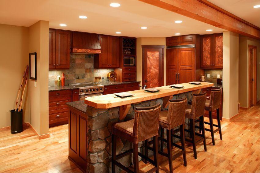 Mediterranean Kitchen with Wood counters, Pier 1 Imports Lurik Barstool, gas range, Raised panel, Breakfast bar, Slate, Flush