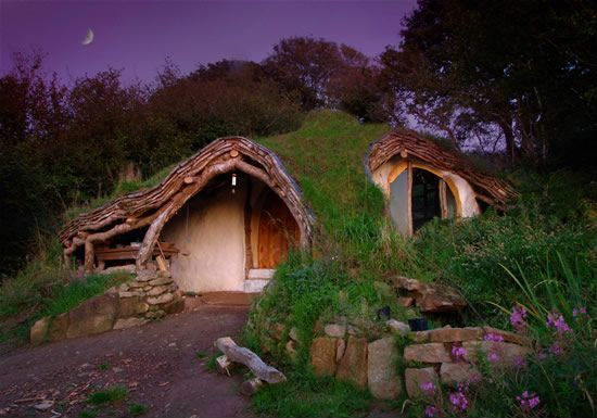 Eclectic Exterior of Home with Solar panels, Skylight, Hobbit house, wales, Straw bale wall construction, Green roof