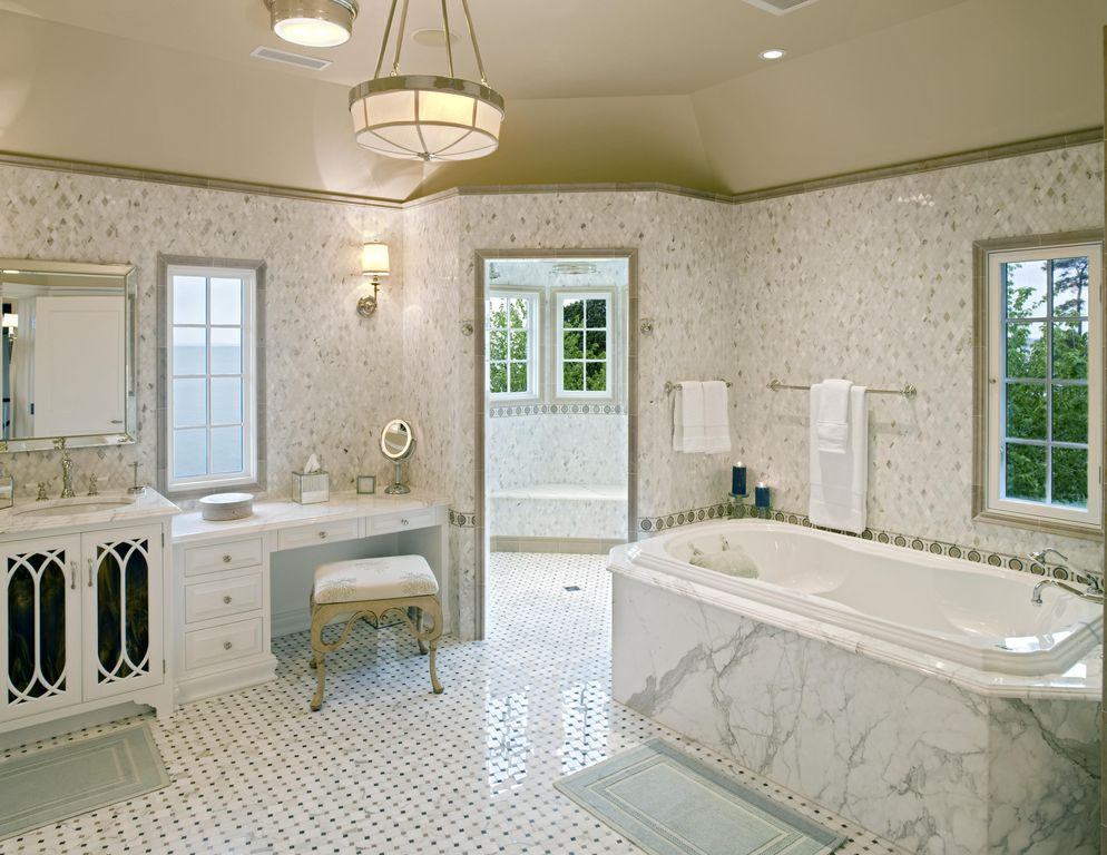 Traditional Master Bathroom with can lights, drop in bathtub, Raised panel, complex marble tile counters, Casement, Bathtub
