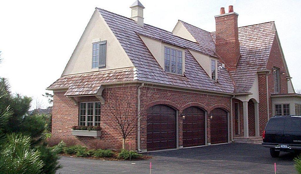 Traditional Garage with interior brick, Concrete floors, High ceiling, six panel door
