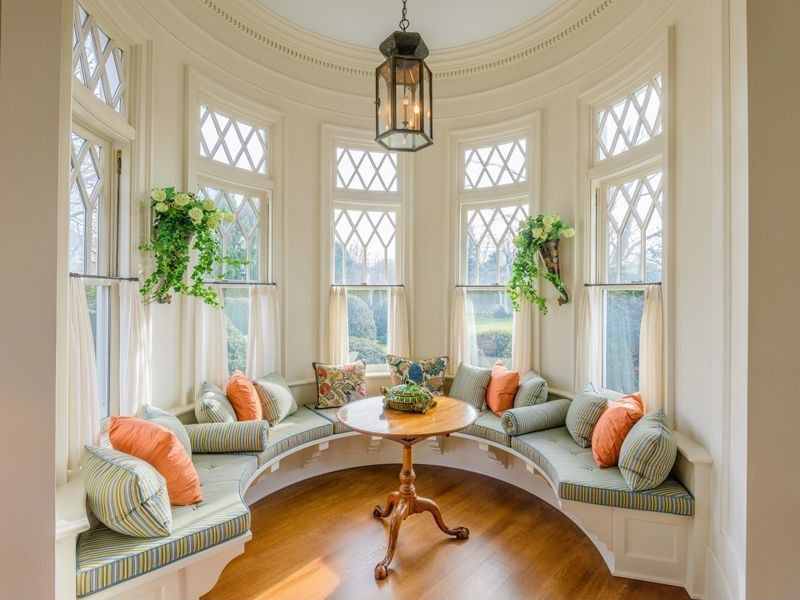 Traditional Living Room with Custom built-in bench seating, Paint 2, Transom window, Paint 1, Coach lantern pendant light