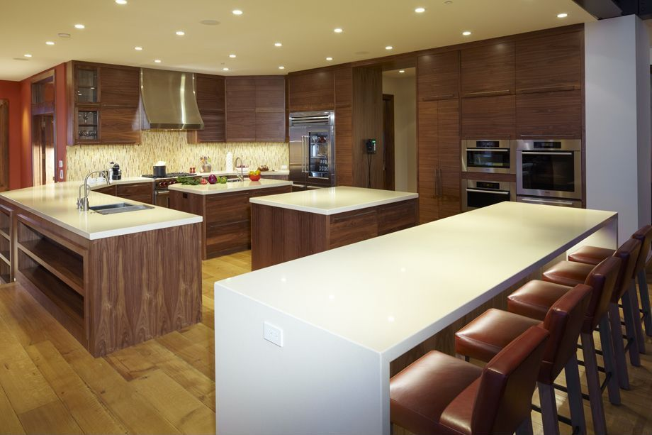 Contemporary Kitchen with Standard height, Wall Hood, Framed Partial Panel, L-shaped, Glass panel, can lights, Kitchen island