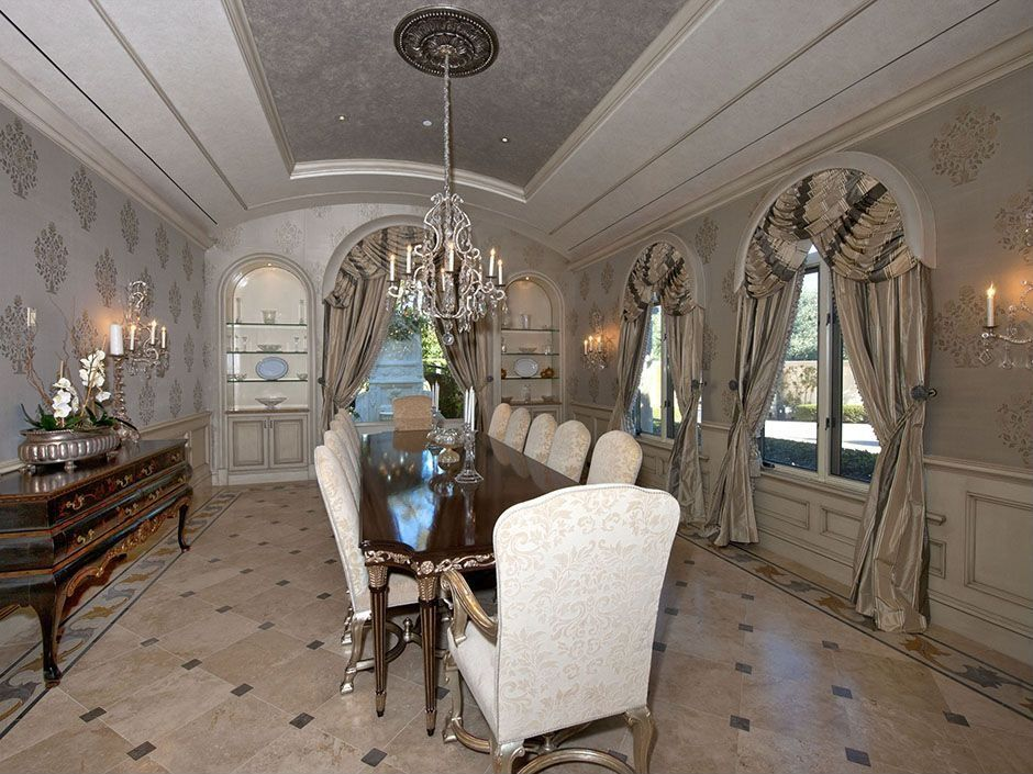 Traditional Dining Room with simple marble tile floors, Wainscotting, interior wallpaper, Chandelier, Crown molding
