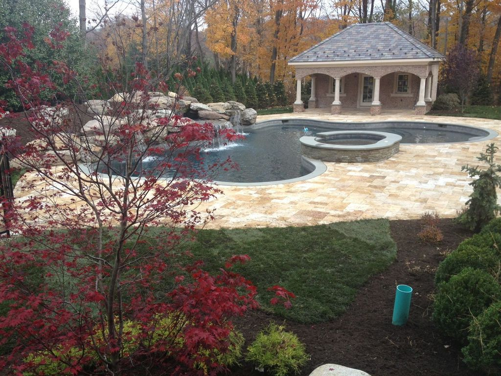 Traditional Swimming Pool with Pool with hot tub, exterior stone floors, French doors, Casement, Gazebo