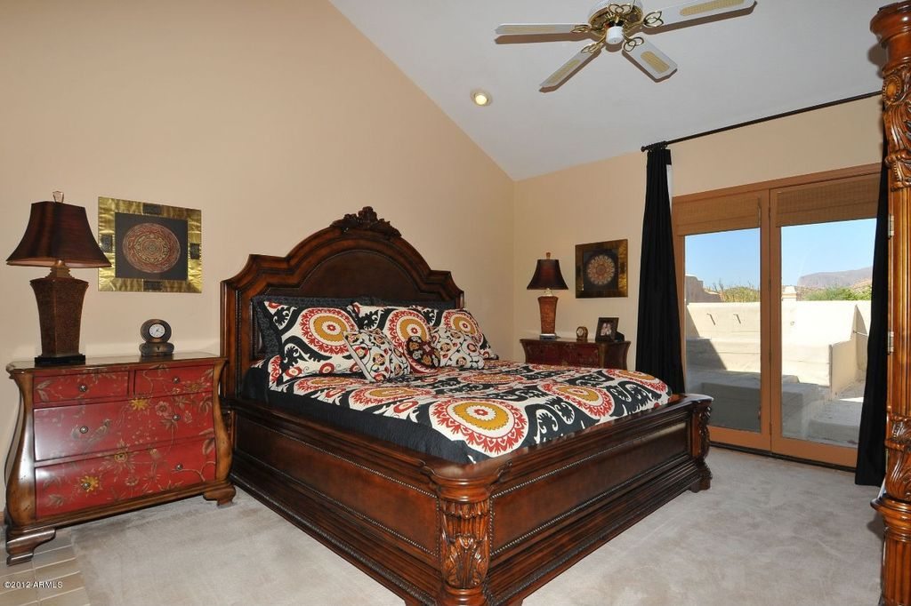 Traditional Master Bedroom with can lights, High ceiling, Ceiling fan, French doors, Hardwood floors