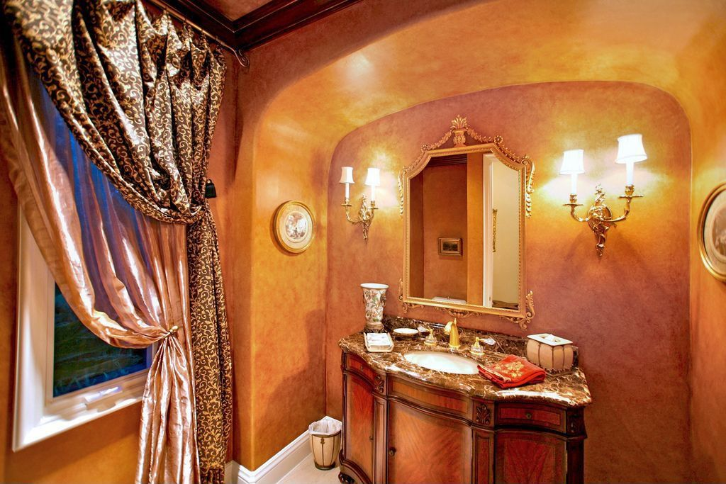 Traditional Powder Room with Wall sconce, Flat panel cabinets, Powder room, Crown molding, Complex granite counters, Flush