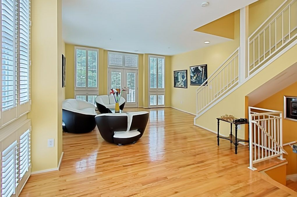 Modern Living Room with Laminate floors, can lights, Standard height, double-hung window, Casement, French doors