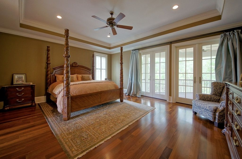 Traditional Guest Bedroom with High ceiling, Hardwood floors, French doors, can lights, Ceiling fan, Casement, Crown molding