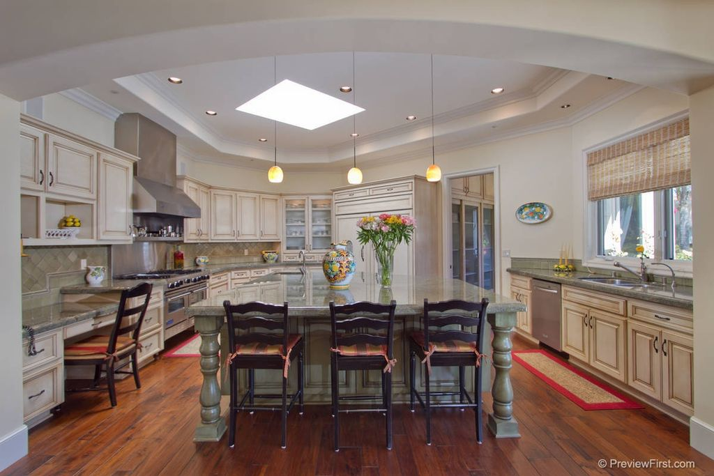 Traditional Kitchen with can lights, Raised panel, Simple granite counters, single dishwasher, partial backsplash, Wall Hood