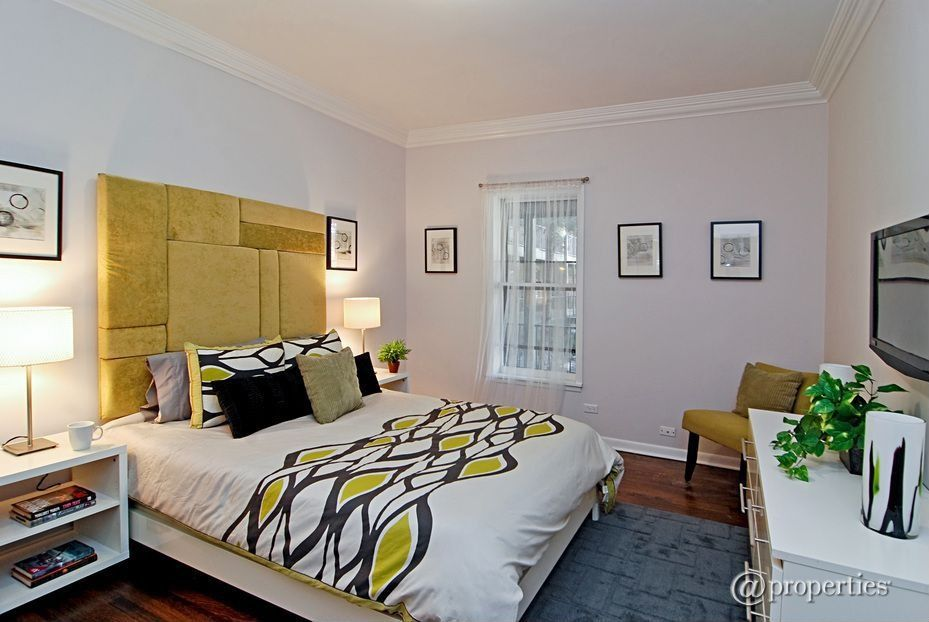 Contemporary Guest Bedroom with Hardwood floors, Carpet, specialty window, Crown molding, Standard height