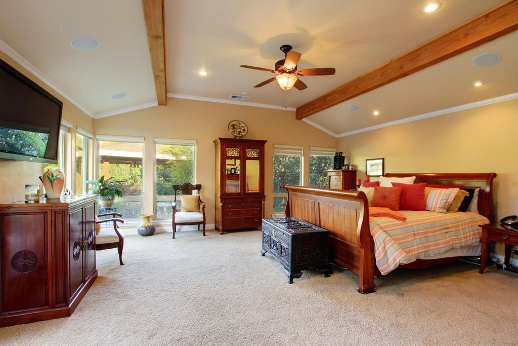 Eclectic Guest Bedroom with flush light, picture window, Carpet, Exposed beam, Ceiling fan, High ceiling, can lights
