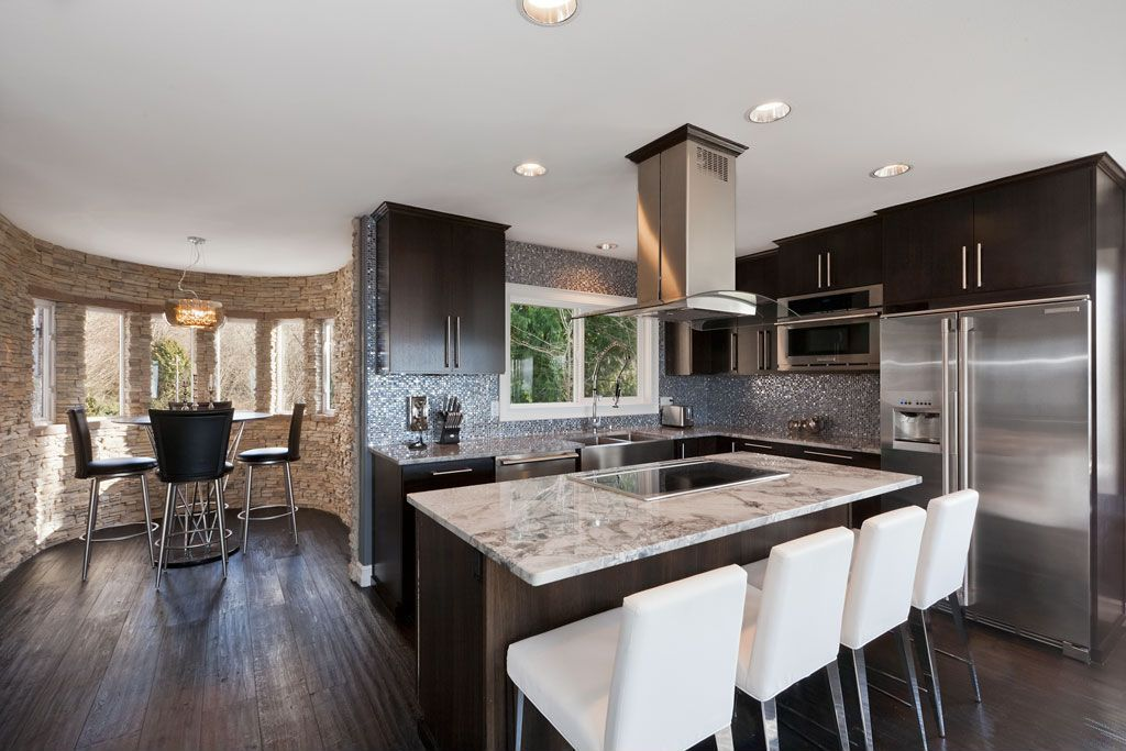 Contemporary Kitchen with Kitchen island, Breakfast nook, Island Hood, Undermount sink, built-in microwave, specialty window