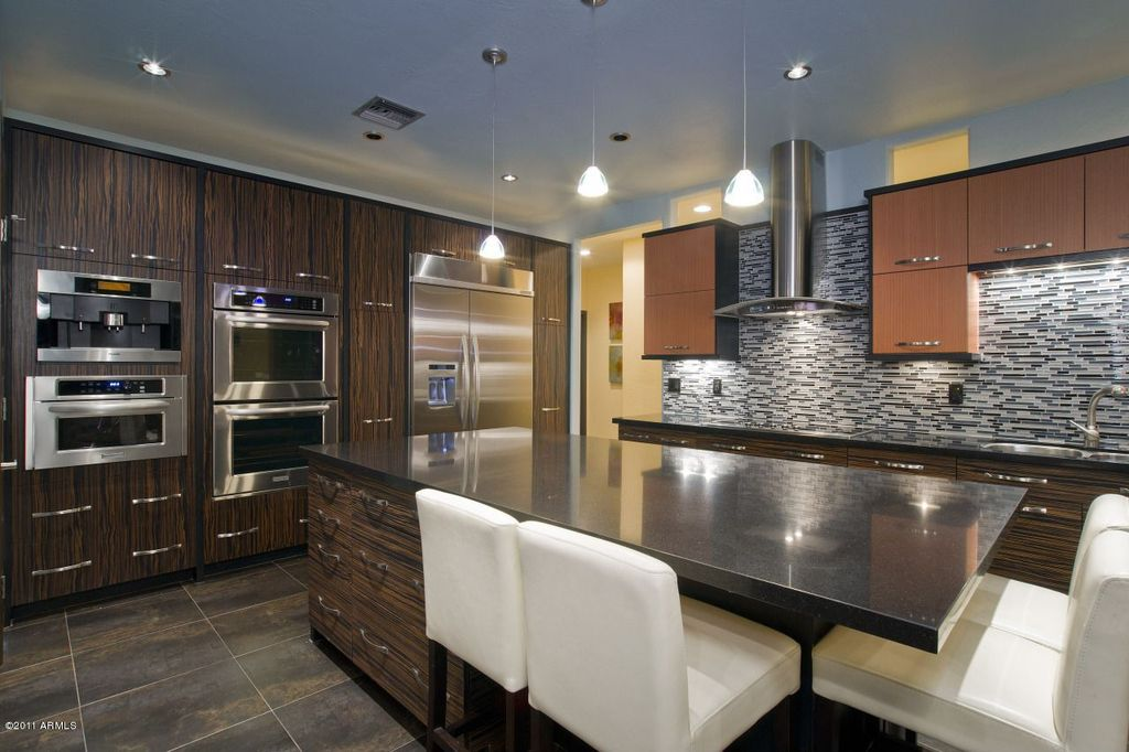 Contemporary Kitchen with Glass Tile, warming oven, Pendant light, Daltile 12x12 slate california gold (honed gauged) s700