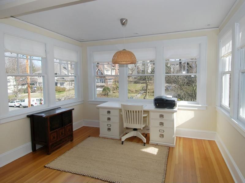 Cottage Home Office with picture window, Wainscotting, Carpet, Pendant light, Standard height, Laminate floors, Casement