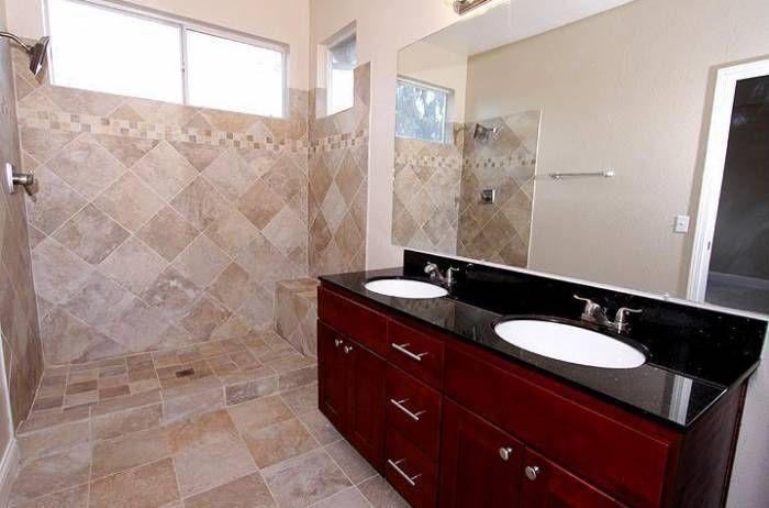 Contemporary Master Bathroom with wall-mounted above mirror bathroom light, full backsplash, Flat panel cabinets, Flush