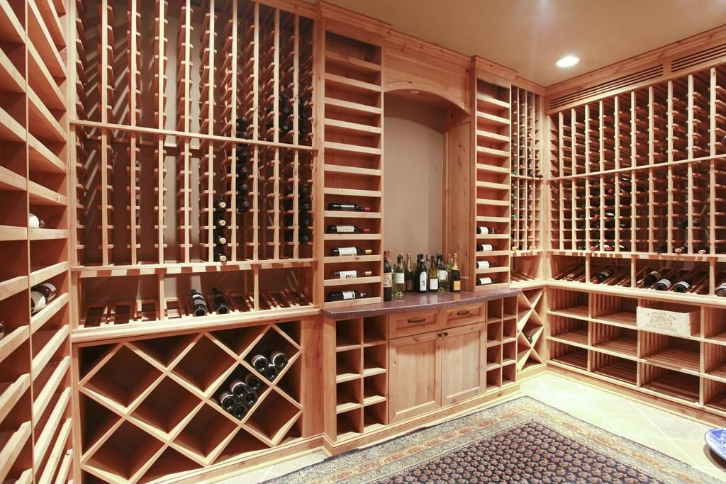 Craftsman Wine Cellar with Carpet, Standard height, Crown molding, simple marble floors, can lights