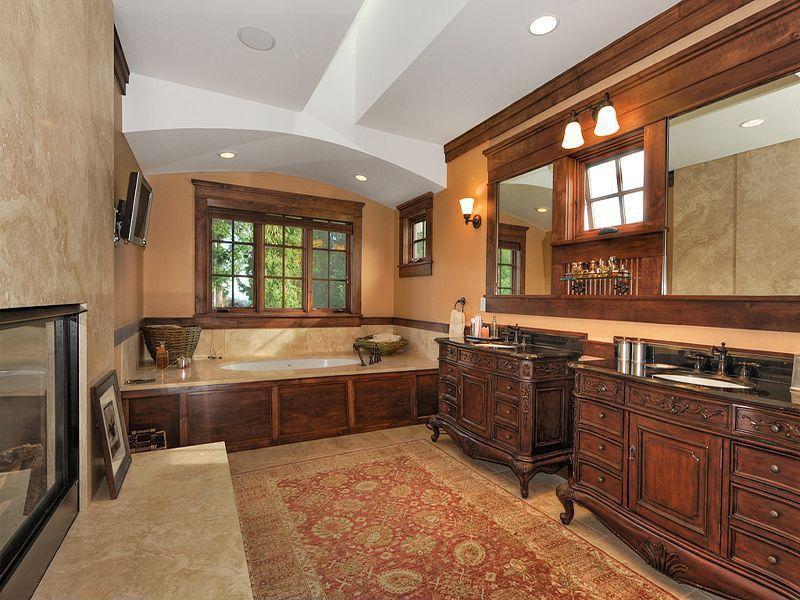 Mediterranean Master Bathroom with Undermount sink, Chair rail, Soapstone counters, Master bathroom, drop in bathtub, Bathtub