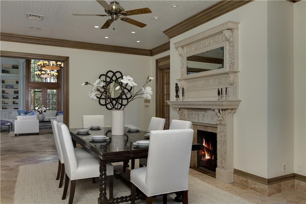 Contemporary Dining Room with Ceiling fan, can lights, Standard height, Arched window, terracotta tile floors, Fireplace